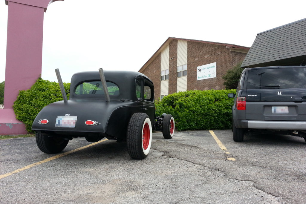 This was a custom ratrod that we built an exhaust system that went up through what would normally be the rear deck lid (usually called the trunk lid).