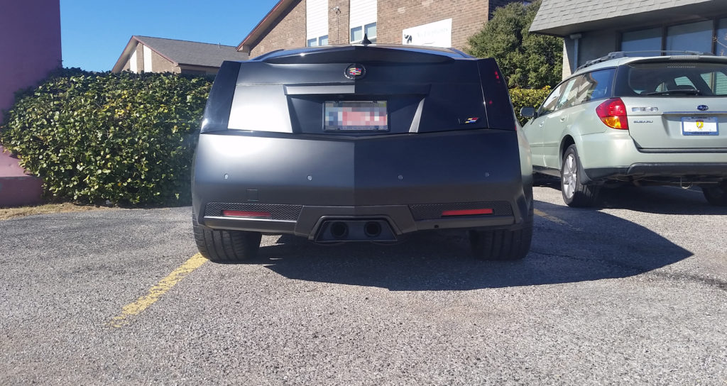 This customer brought their late model, Cadillac CTS-V in after having a custom exhaust tip made and power-coated. We had to modify the tip - cutting holes for the exhaust pipes - to install it, but we made certain we got it mounted as perfectly as was possible.